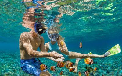 Pareja haciendo snorkel en Isla Mujeres